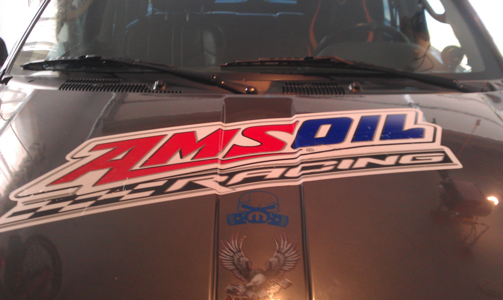 Big Amsoil Sticker on Jeep